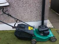 Push petrol lawnmower with grass box