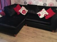 Black velvet corner couch and two seater