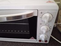 A two burner mini oven used twice immaculate condition