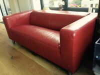 Red IKEA 'Klippan' Two seat sofa
