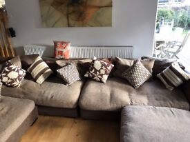 Large DFS Corner Sofa lounging style with lots of cushions