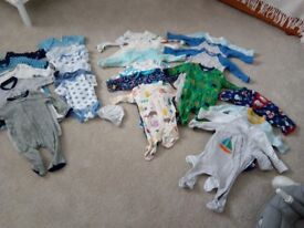 Lovely selection of babygros and vests