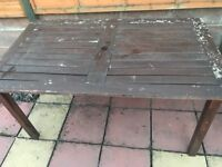 Wooden garden furniture, large table, 2 benches and 2 chairs needs repairs