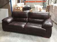 Brown soft leather three seater sofa hardly used been in storage