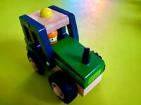 Squirrel Play Wooden Tractor in as new condition