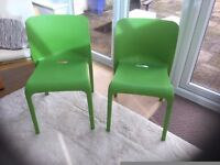 PAIR OF GREEN PLASTIC CHAIRS