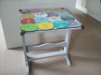 Fold up glass topped table
