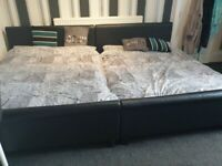 2 black faux leather double beds with mattressed