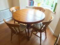 **Extendable round wooden dining table + 4 chairs** (Collection only)