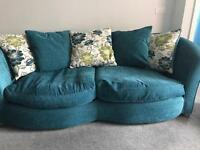 2 seater and 3 seater sofas. Teal coloured with teal and green floral cushions.