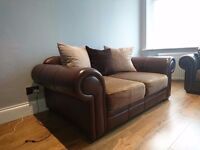 Brown half leather two seater sofa and armchair