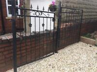 Heavy iron gates. With posts