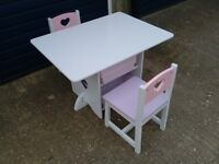 Table and 2 chair for nursery or playroom with storage for bits and pieces in good condition