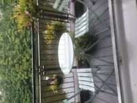 lovely patio table with folding chairs