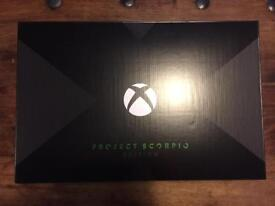 Xbox One X Scorpio Edition with Logitech stereo headphones and controller charging dock