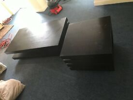Beautiful solid black modern coffee table with matching side table