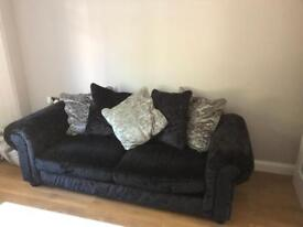 Two seater crushed velvet and black sofa