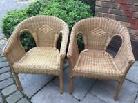 Two ample-sized wicker chairs. Ideal for use in garden or conservatory. Excellent condition.