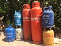 Various empty gas bottles .