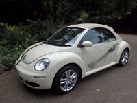 VW BEETLE CABROLET with cream bodywork and beige hood - Registered 2011