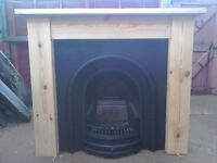 LARGE CAST IRON FIREPLACE AND SOLID PINE SURROUND. EXCELLENT CONDITION.