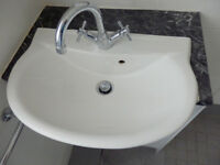 Ceramic wash basin with mixer taps
