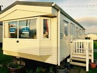 3 bed sleeps 8 static caravan for sale with decking at sandy bay NE63 9YD for SAT NAV 12 months