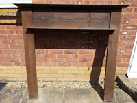 Solid wood fire surround with decorative mouldings.
