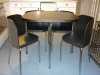dining table and chairs black colour