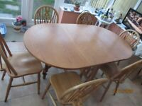 TEAK DINING TABLE WITH 6 CHAIRS / OVAL SHAPE / DROP LEAF SIDES