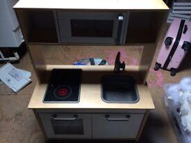 Children's play kitchen and accessories