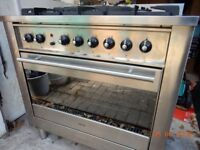 Ariston 90cm wide 60cm deep cooker. Five gas burners and large single electric oven with grill.