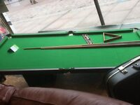 Snooker table with cues and balls etc