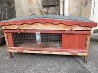 Rabbit hutch (138cmx70cmx50cm) in good condition and other bunny accessories (water bottle, etc)