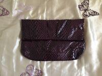 Purple snakeskin clutch bag