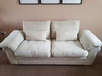Cream fabric three seater sofa and arm chair