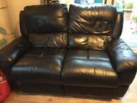 """2 2 black leather reclining sofas. Length 5'2"""" depth 32"""" height34"""""""
