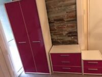Pink bedroom furniture set. 3 piece set, including wardrobe, chest of drawers and bedside drawers.