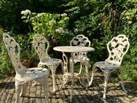 Vintage cream cast iron garden furniture set