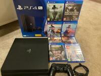 PlayStation 4 PRO (Ps4 pro ) like new with original box all leads manuals etc and 8 games