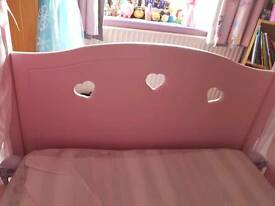 Pink four poster single bed