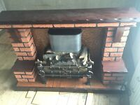 Solid mahogany & brick fireplace with electric fire
