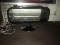 Glossy black curved tv stand with glass shelf and metal base