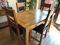 Solid wood extending dining table plus 4 chairs (can make 6) Oak