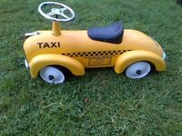 cute metal ride-on toy car in Ney York Taxi design in very good condition