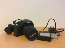 Canon 450D = 18-55mm + battery charger and 2 batteries
