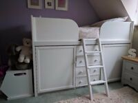 White wood painted child's cabin bed with storage