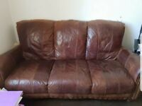 Brown leather three seater and armchair