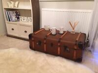 Wooden bound vintage trunk coffee table