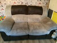 Two seater cord and leather recliner sofa from DFS for sale